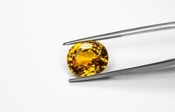 Topaz and clamp. The topaz with the clamp on white background royalty free stock images