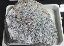 Topaz greisen intrusive igneous rocks. Intrusive igneous rocks. Geological collection in Colombia for geologists. Study of soils, minerals and rocks. Sample Stock Photos