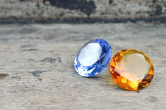 Topaz and Sapphire. On the wood Royalty Free Stock Image