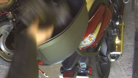 Topcase motorcycle. Filmed in motion on a motorcycle in busy city traffic stock footage