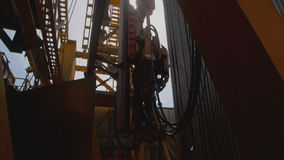Topdrive for Oil Drilling Rig. Top Drive System and Derrick of Oil Drilling Rig stock footage