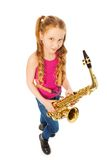 Tope view of smiling girl holding alto saxophone Stock Photography