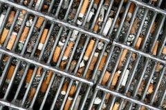 Topes de cigarrillo Imágenes de archivo libres de regalías