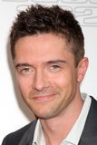 Topher Grace. LOS ANGELES - JUN 9:  Topher Grace arriving at the Art of Elysium Return of Ford Mustang Boss Event at The Residences at W Hollywood on June 9 Stock Photography
