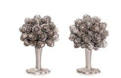 Topiary de prata feito do nob do abeto sobre o fundo branco Fotografia de Stock Royalty Free