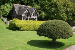 Topiary in front of an ancient aviary Stock Image