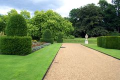 Topiary garden with ornament and parterre Royalty Free Stock Image
