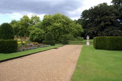 Topiary garden with ornament and parterre Stock Images