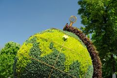 Topiary globe made of green plants in Orel, Russia Stock Image