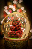 Topiary Snow Globe. This is a snow globe containing a topiary Stock Photo