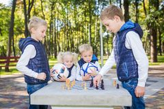 The topic children learning, logical development, mind and math, miscalculation moves advance. large family brothers and sister royalty free stock photo