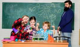 Topic of our club. Club include variety of activities with chemistry. School club education. Teacher and pupils test. Tubes in classroom. Chemistry themed club royalty free stock photography
