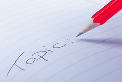 Topic. Word topic written on paper with pencil close up Stock Images