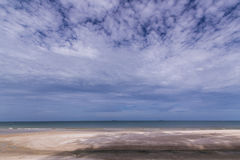 The topical beach. With huge cloud in the sky Royalty Free Stock Image