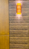 Topical orange lamp. On wood wall Royalty Free Stock Photo