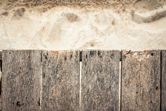 Topical wooden planked surface with sandy beach on background and copy space. Horizontal aged brown wooden tropical background. Obsolete wooden texture Stock Photos