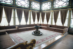 Topkapi palace in Istanbul. ISTANBUL,TURKEY- MARCH 20,2014: Beautifully decorated vintage audience hall of Sultan at Topkapi palace in Istanbul Stock Photos