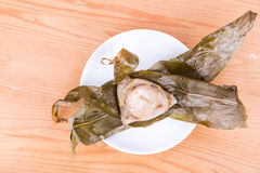 Toplay view on freshly prepared Chinese rice dumpling or zongzi unwrapped on pl Stock Photo
