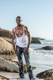 Topless african black tearing white shirt Royalty Free Stock Photography