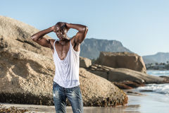 Topless african black tearing white shirt Royalty Free Stock Photos