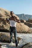Topless african black tearing white shirt Stock Image