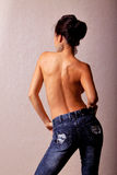 Topless asian woman in blue jeans Stock Images