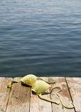 Topless at the beach. Bikini top left on pier Royalty Free Stock Photography