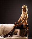 Topless blond female on a sofa Royalty Free Stock Images