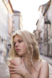 Topless blonde model at the street. Topless young   model  at the street Royalty Free Stock Image