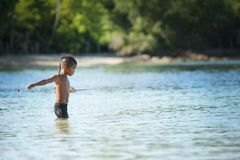 Topless Boy Wearing Black Shorts Standing on Bodies of Water Royalty Free Stock Photography
