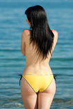 Topless brunette at the sea Royalty Free Stock Photography