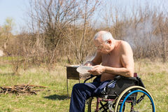Topless Disabled Old Man Eating at the Park Alone Stock Photography