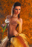 Topless erotic girl with flower Stock Image