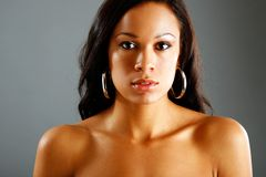 Topless fashion look. Young African-american woman poses for a simple portrait Stock Photos