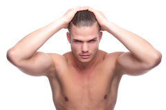 Topless fashion man with hands on head Royalty Free Stock Photography