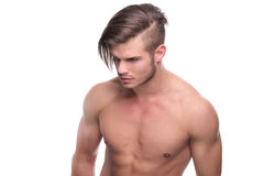 Topless fashion man with nice hairdo. Young fashion topless man looking down, away from the camera. isolated on white background Royalty Free Stock Image