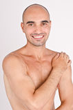 Topless fit Caucasian bald man laughing. Stock Images