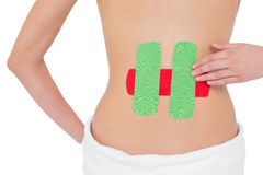 Topless fit woman with red and green strips on back Royalty Free Stock Photo