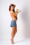 Topless girl. With long hair in skirt is covering her breasts with hair and holding shoes Royalty Free Stock Images