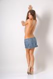 Topless girl. With long hair in skirt is covering her breasts Royalty Free Stock Photos