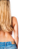 Topless girl from behind with long blonde hair. Wearing blue jeans and isolated on white background Stock Image