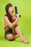 Topless girl in garrison cap with gun Royalty Free Stock Photography