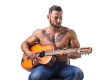 Topless handsome man playing guitar Royalty Free Stock Image