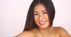 Topless Japanese woman looking at camera. Smiling royalty free stock photo