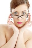Topless lady in black plastic eyeglasses Stock Images