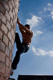Topless male climbing Royalty Free Stock Images