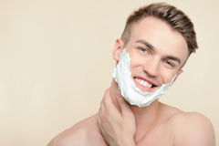 Topless man applying mean of shaving on face Royalty Free Stock Photos