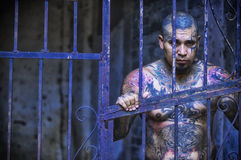 Topless Man Inside Prison Cell Royalty Free Stock Images