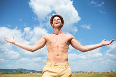Topless man laughing outdoor with arms wide open Royalty Free Stock Photography