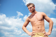 Topless man outdoor with hands on hips looks away Royalty Free Stock Images